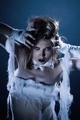 Portrait of attractive girl posing as zombie