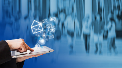 Businesswoman sending email