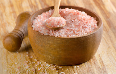 himalayan pink salt in a wooden bowl.