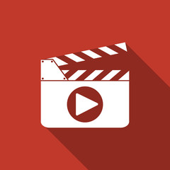 film slate play button icon with long shadow
