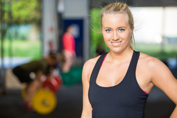 Portrait Of Confident Fit Woman at Cross-Fitness Gym