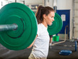 canvas print picture - Fit Woman Lifting Barbell in Gym