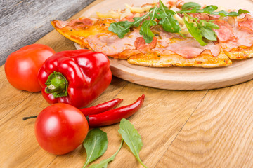 Delicious pizza with fresh herbs, tomatos and pepper