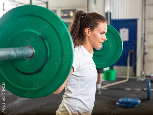 canvas print picture Fit Woman Lifting Barbell in Gym