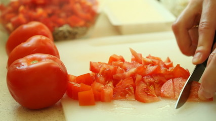 food. slicing with kitchen knife red tomato vegetable