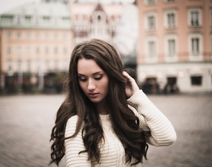 Beautiful girl in old european town