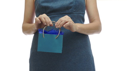 Woman Holding Small Blue Gift Bag