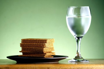 Stack of soda crackers and a goblet of water
