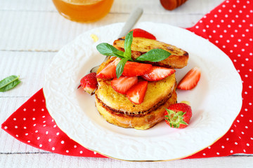 French toast with slices of berries