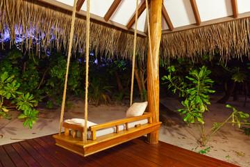 Beach bungalow at sunset - Maldives