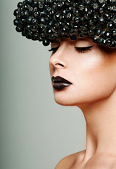 beautiful female face. professional makeup. black berries.