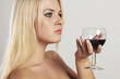 Beautiful blond woman drinking red wine.girl with alcohol