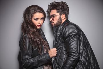 Beautiful fashion woman pulling her boyfriends jacket