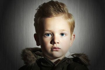 Fashionable child in winter coat. fashion children.boy hairstyle
