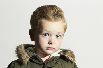 surprised child.little boy with big eyes.hairstyle.winter style