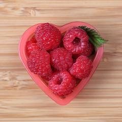 Raspberries in a heart bowl