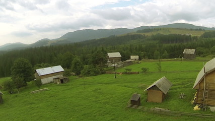 mountain   with wood and village  .Aerial  shot in summer day