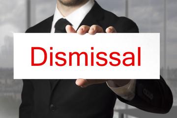 businessman showing sign dismissal