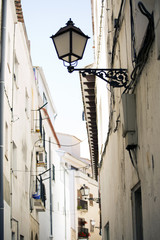 Ancient small lamps on the street. Europe.