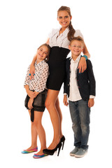 beautiful young mother with  daughter and son isolated over whit