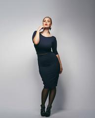 Beautiful plus size secretary in sexy dress