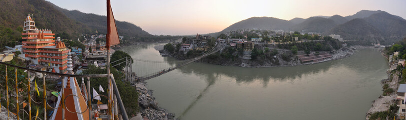 Holy Ganges river in Rishikesh with Hindu temples