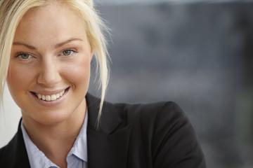 Portrait of mid adult businesswoman, smiling
