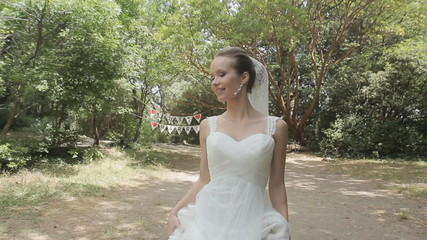 Young slim bride goes to the forest