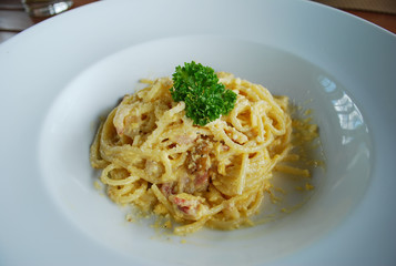 Spaghetti Carbonara in the white dish