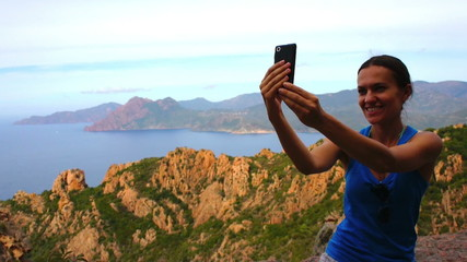Young woman take a selfie photo by the sea