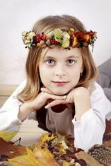 Beautiful girl wearing autumn wreath
