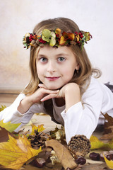 Beautiful girl with autumn wreath