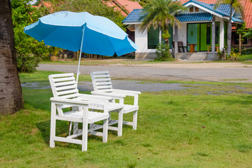 white chair set and umbrella on grass floor