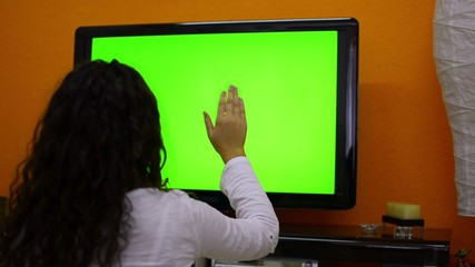 Girl makes touchless control on smart tv