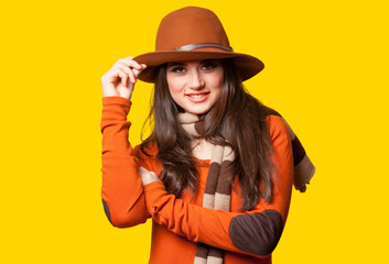 Style brunette girl on yellow background.