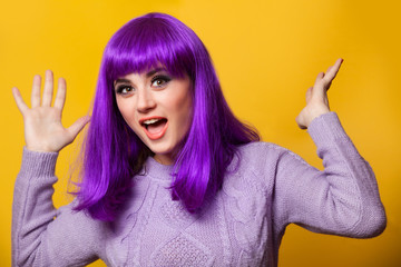 Happy girl with violet hair on violet background.