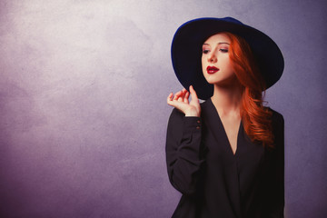 Style redhead women in black on classic background