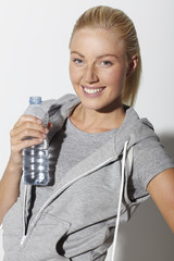 Portrait of mid adult woman holding water bottle