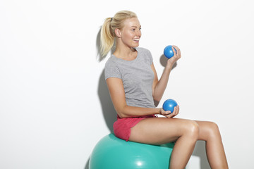 Mid adult woman exercising on Swiss ball