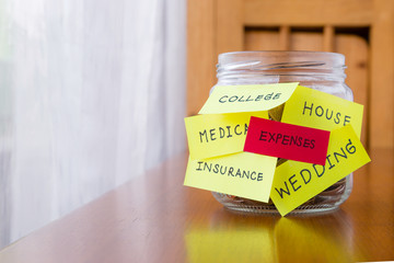 Expenses and orther tags on savings money jar