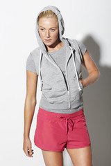 Mid adult woman in sportswear, studio
