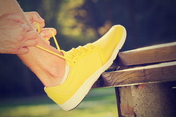 Tying the running shoes.