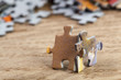 Two Jigsaw Puzzle Pieces on Table - 71811867