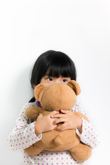 Little Asian girl with teddy bear