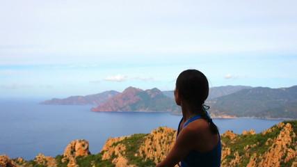 Young female tourist enjoying beautiful view, Corsica