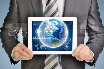 Man hands using tablet pc. Image of Earth and business elements