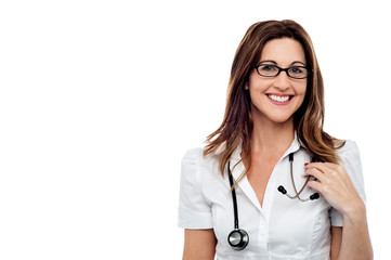 Smiling female doctor, isolated over white
