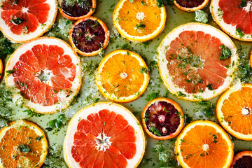 Ripe red oranges and grapefruits cut by rings