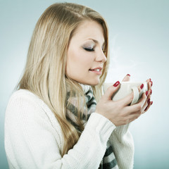 Young woman with hot drink