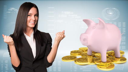Joyful businesswoman smiling and raise your hands up. Piggy bank